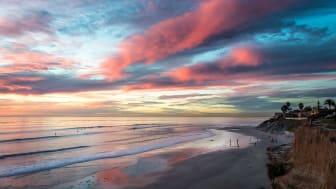 Cliffs and a beach at sunset