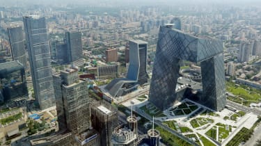 BEIJING, CHINA - AUGUST 03:A general view shows the headquarter of China Central Television amid the Beijing skyline at central business district on August 3, 2013 in Beijing, China.(Photo by