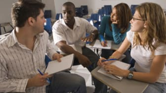 University students in discussion in the classroom