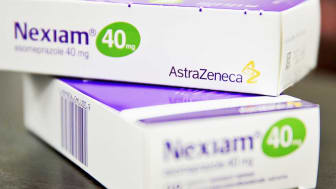 JOHANNESBURG, CAMBRIDGESHIRE - MAY 15:Nexiam (Generic name - Esomeprazole) made by the pharmaceutical firm AstraZeneca are displayed in a Pharmacy on May 15, 2014 in Johannesburg, South Afric