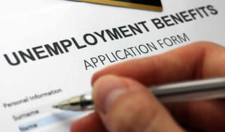 A person filling out an unemployment benefits form