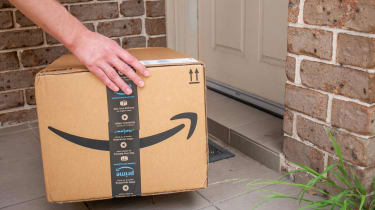 Amazon prime box delivered to a front door of residential building