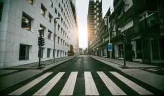 Empty Urban Street with Skyscraper at Sunrise