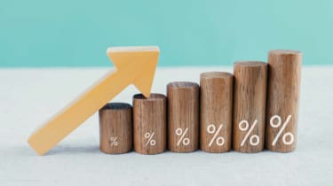 rising interest rate concept with wooden blocks