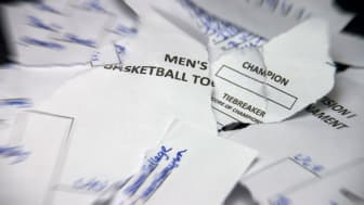 picture of torn up basketball tournament bracket sheet
