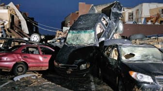 picture of cars piled up after a natural disaster