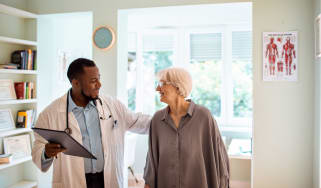A doctor speaks with a patient who looks happy.