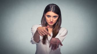 picture of woman making hand gesture indicating she wants more money