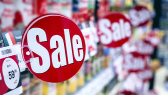 """Several """"sale"""" signs in a store"""