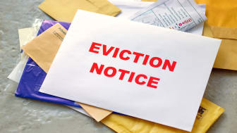 picture of eviction notice in stack of mail