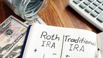 Picture of Notebook with Roth IRA and Traditional IRA Written Down