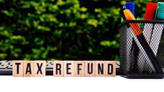 "picture of blocks spelling out ""tax refund"""
