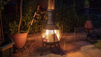 A chiminea in a backyard.