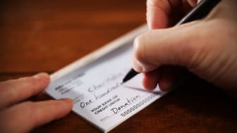Person writing check