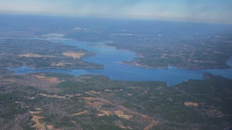 An aerial shot of a body of water and land