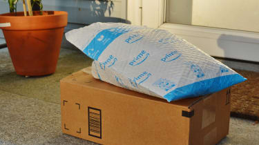 Amazon packages sitting on a front stoop