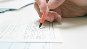 picture of a person signing a legal document