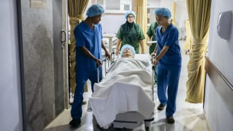 Doctors wheeling a patient on a gurney