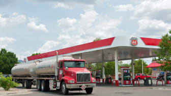 Albuquerque, New Mexico, USA - July 2, 2011: Phillips 66 gasoline and service station with Groendyke semi tanker truck and trailor in North East Albuquerque. Picture taken on partially cloudy