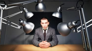 Job candidate sits under strong lights
