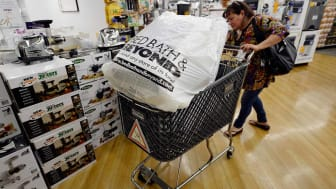 LOS ANGELES, CA - APRIL 10:Customers carry bags fromBed Bath & Beyond store on April 10, 2013 in Los Angeles, California. The home goods retailer is expected to release fourth-quarter earning