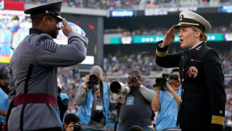 picture of West Point first captain and Naval Academy brigade commander saluting each other before Army-Navy game