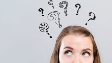 A woman with several question marks above her head.