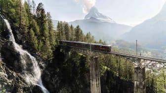 train driving through mountains