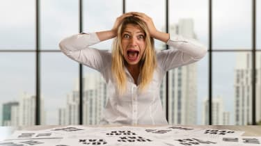 woman surprised by tax forms