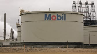 JOLIET, IL - JANUARY 30:The Mobil logo is painted on a storage tank at the Exxon Mobil Corp. refinery January 30, 2006 in Joliet, Illinois. Exxon Mobil posted a record $10.71 billion profit f