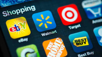 The Walmart app seen with several apps on a phone screen