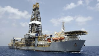 A drill ship at open ocean drilling location. Ship has helideck at bow and a double drill tower. Drill ships can drill in deeper water than many other offshore drilling platforms. They are of