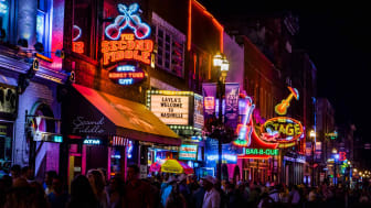 Neon signs on Lower Broadway at night in vibrant downtown Nashville, Tennessee