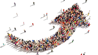 A mass of people forming an upward-pointing arrow