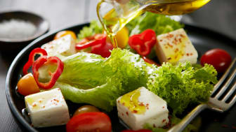 Feta salad with red bell peppers, tomatoes and olive oil