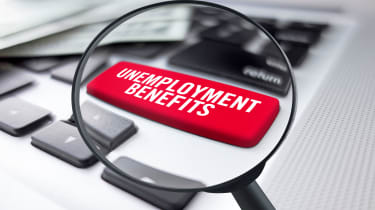 """picture of magnified computer keyboard button that says """"unemployment benefits"""""""