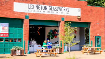 Seniors reading a brochure outside of Lexington Glassworks in North Carolina