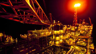 An oil rig at night