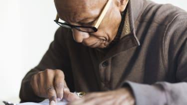 Older Black man reading notes