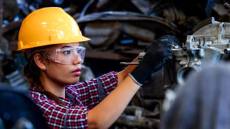 A woman performing industrial work
