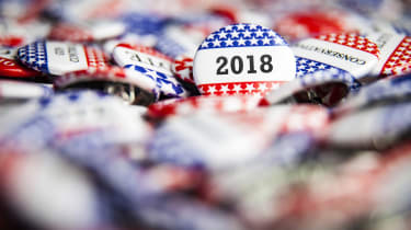 A 2018 Election Vote button on a pile of other buttons