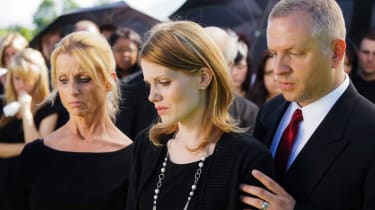 Photo of grieving family at graveside