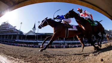 picture of horses racing at Churchill Downs