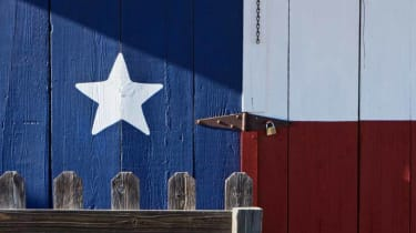 picture of a barn door with Texas flag painted on it