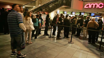 "NEW YORK - MAY 19:Fans wait in line to buy remaining tickets to popular movies including ""The Da Vinci Code"" May 19, 2006 at the AMC Theaters on 42nd Street in New York City. Worldwide protes"