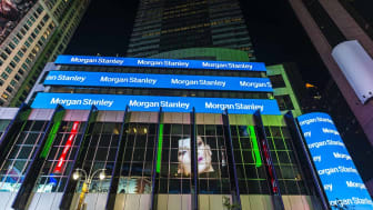 New York City, USA - July 30, 2018: Headquarters of Morgan Stanley at night on Broadway Avenue next to Times Square with large advertising screens in Manhattan in New York City, USA