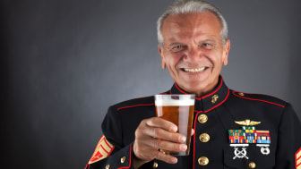 photo of retired Marine hold glass of beer