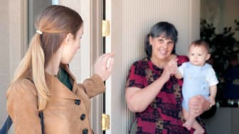 picture of a mother leaving the house and saying goodbye to nanny and child