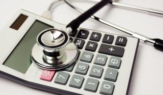 Stethoscope on calculator Medicare costs