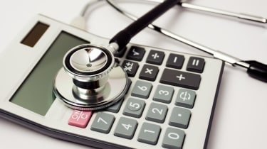 Stethoscope on calculator Medicare costs
